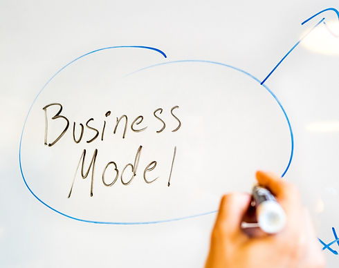 Business Model written on white board