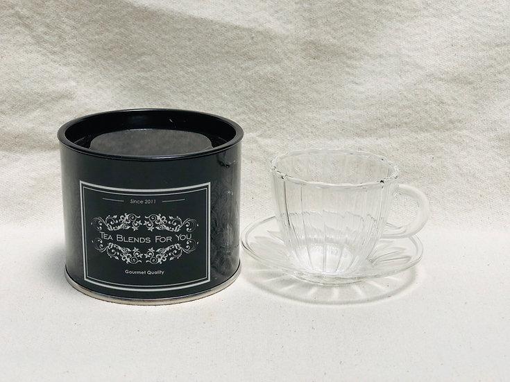 Taza de café con plato de vidrio
