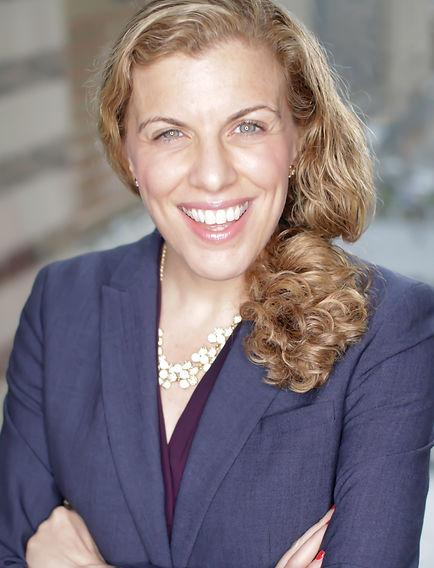 Gina, a white woman smiling at a camera