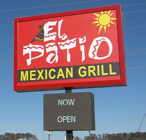 El Patio Now Open Sign Croped.png