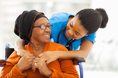 Nurse aide helping resident