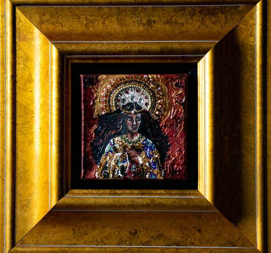 Black Madonna, with gold frame.