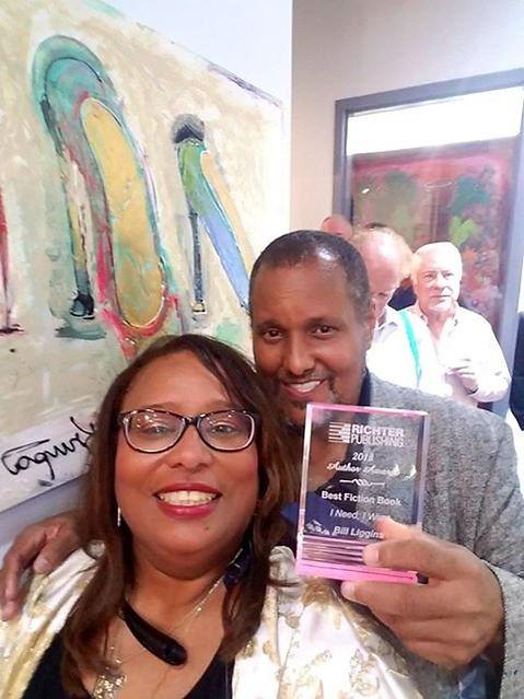 Me and yoli with award.jpg