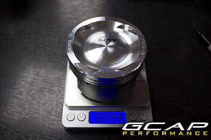 Forged pistons weighed and balanced
