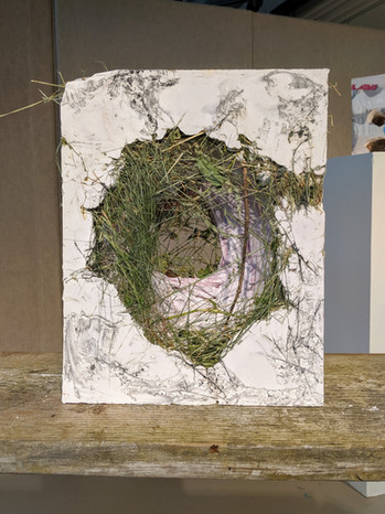 """Compost, 2019. Plaster, grass, and found material. 15""""x11.5""""x4"""""""
