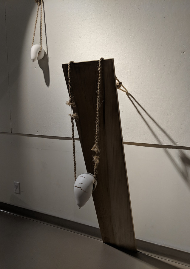 Installation view, Choked and By a Thread, 2018. Plaster, rope, and wood.