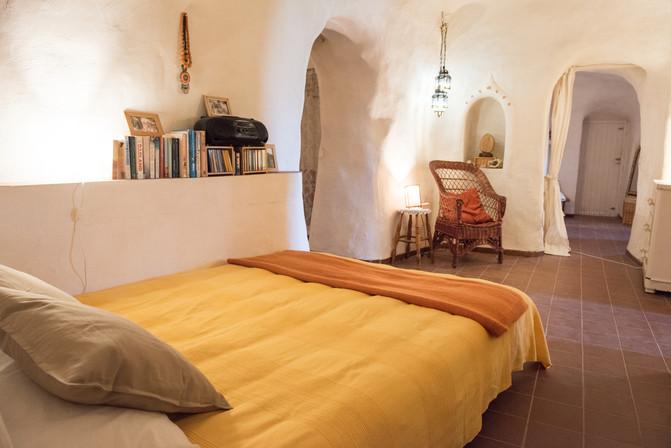 Sofa bed in cave bedroom