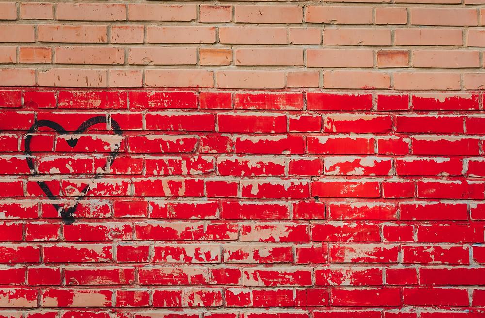 Rode_WeAchieve_muur
