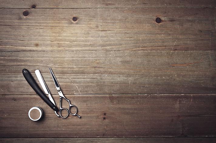 Vintage barber equipment on wood desk.jp