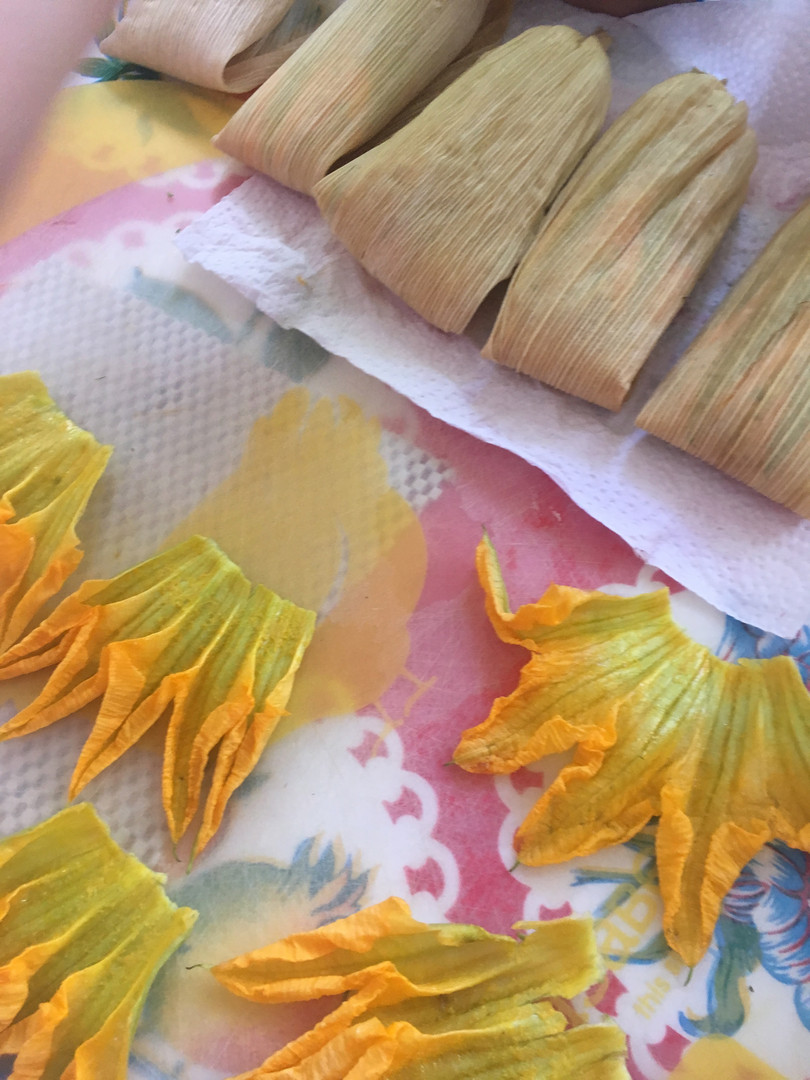 making tamales with squash blossom