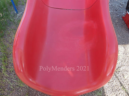 Damaged red slide fully repaired