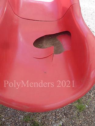 Broken red playground slide