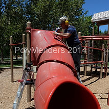 Ron welding a large crack on the top of a tunel slide at a park.