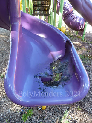 Photo of very large burn hole in playground slide