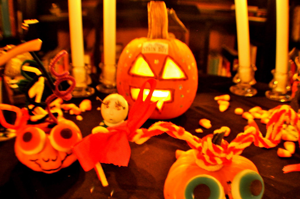 Pumpkins and halloween decorations on table