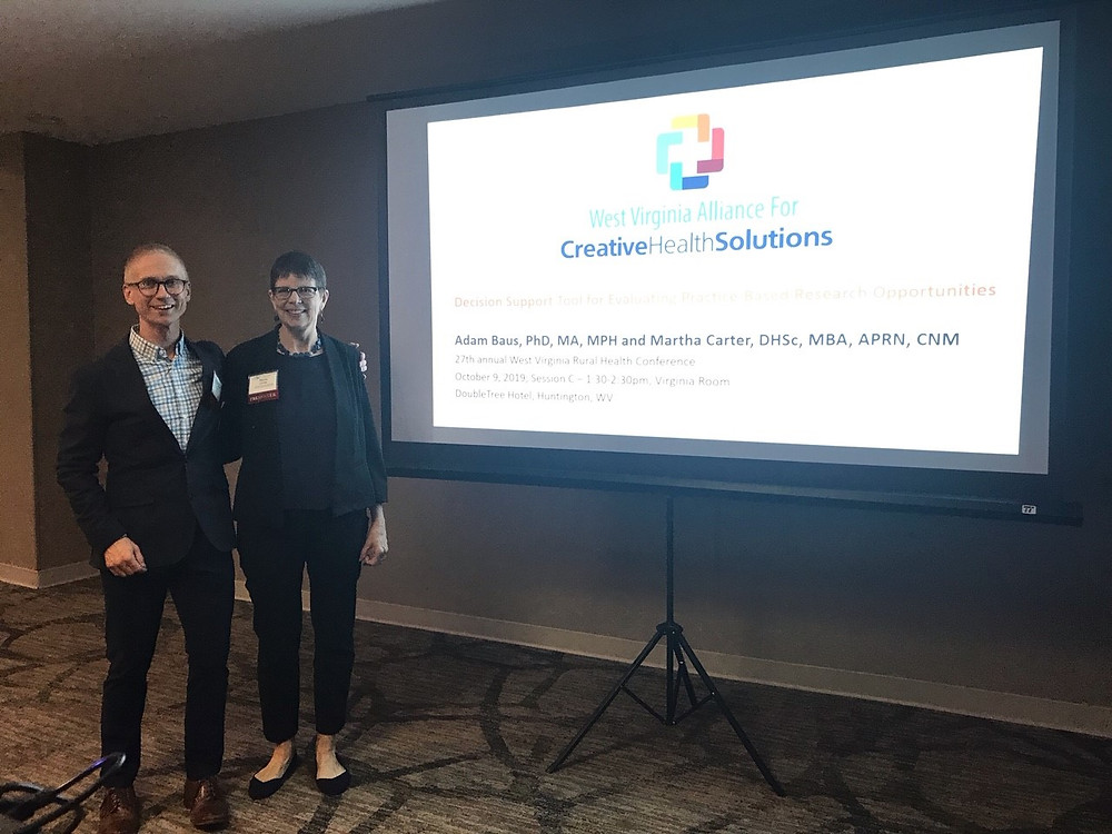 Adam Baus and Martha Carter, together at their presentation at the 2019 WV Rural Health Association Conference.