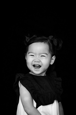 Girl smiling in black and white