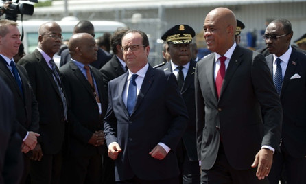 Hollande promises to pay 'moral debt' to former colony Haiti