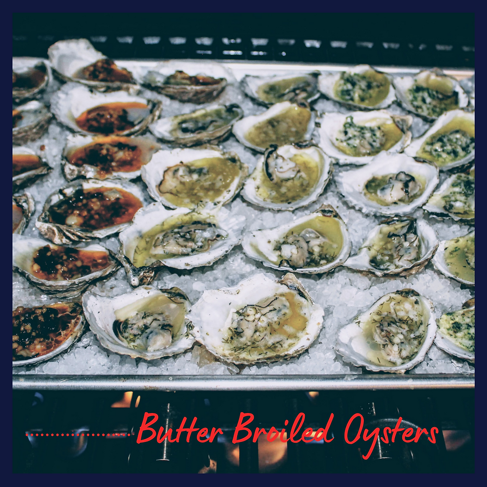 Grilled Broiled Oysters on rock salt with butter