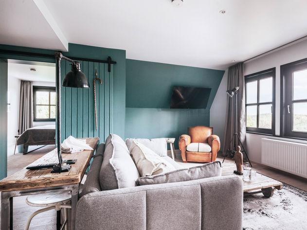 Wohnraum mit Club Sessel