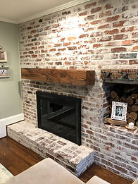 Reclaimed wood mantels over fireplace