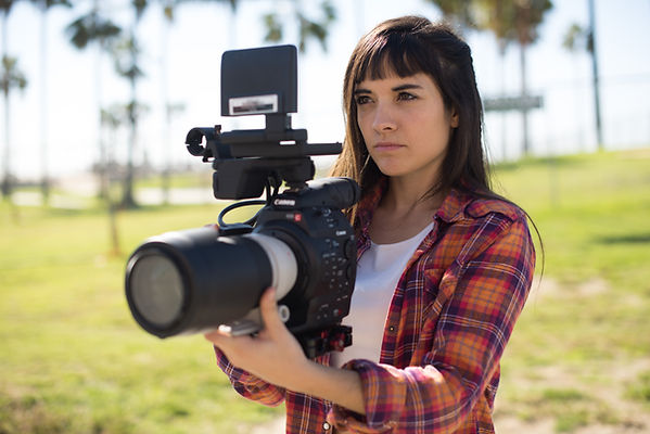 Woman Filmming with Canon