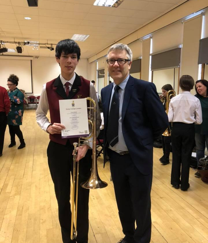 Caius Walker receiving his Trinity College London award after the NYBBS 2018 course