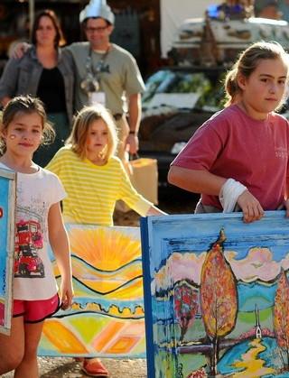 Children holding Art at the Kentuck Festival