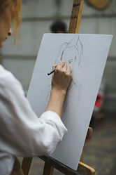 woman-in-white-long-sleeve-shirt-drawing