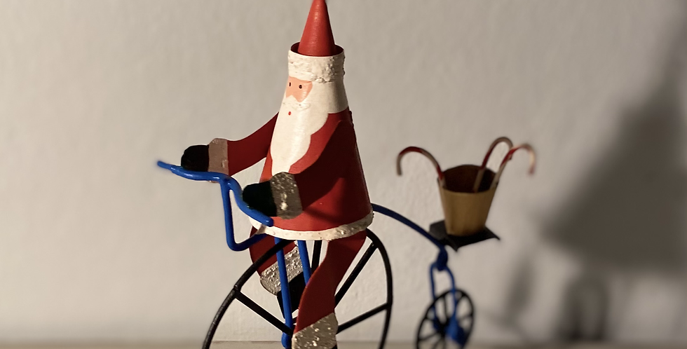 Father Christmas on his penny-farthing