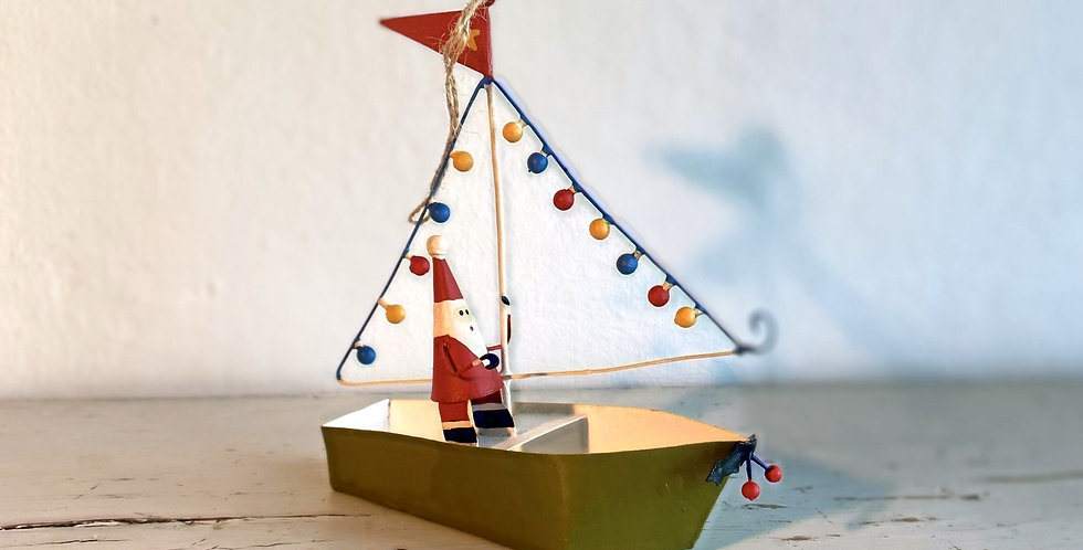 Father Christmas in his boat with lights