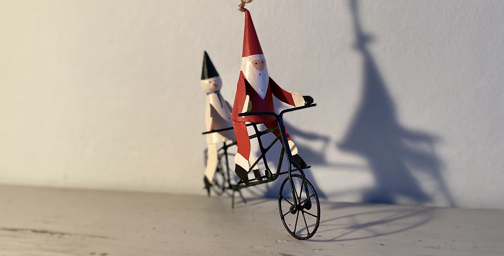 Father Christmas on a tandem with a snowman
