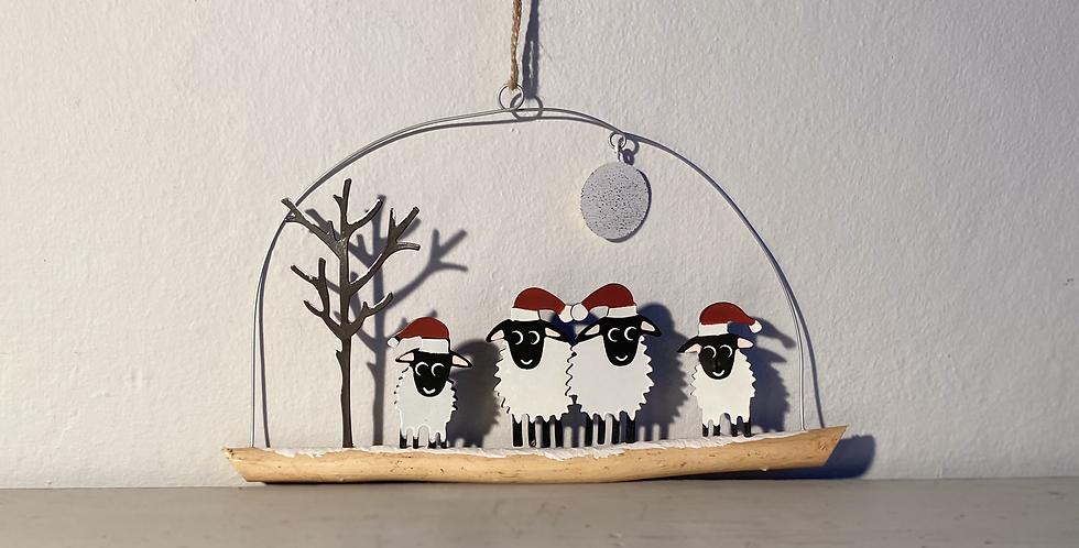 Four sheep loving the snow