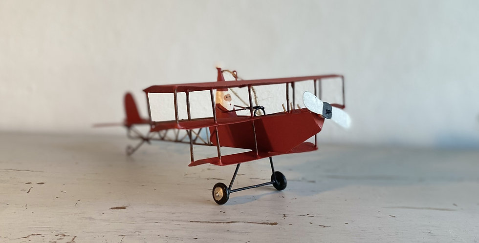 Father Christmas in his bi-plane