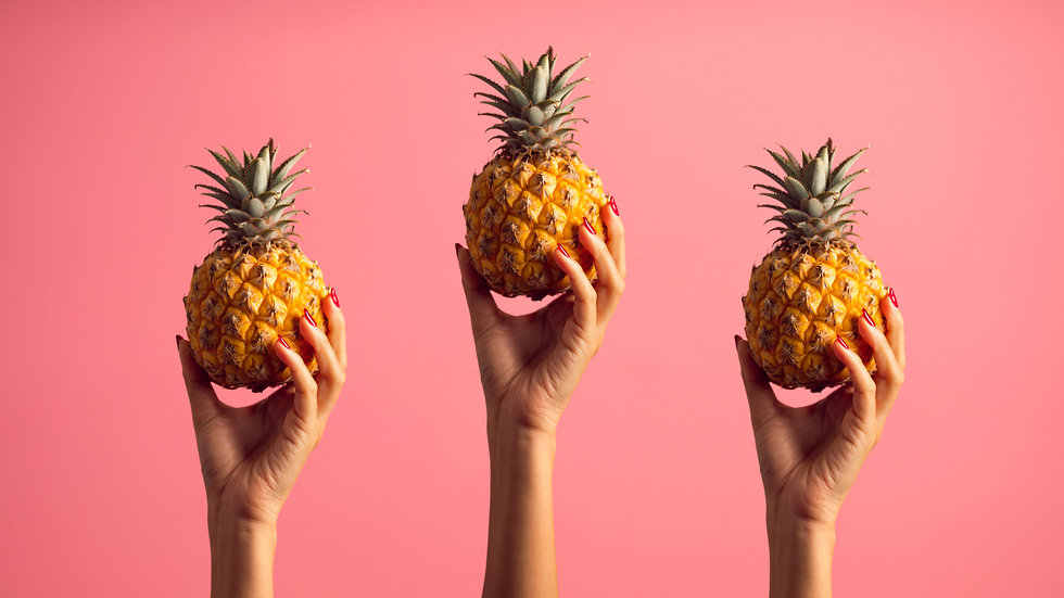 person-holding-pineapples-2964834.jpg