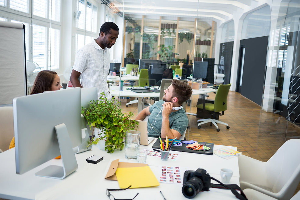 graphic-designers-interacting-at-their-desk-PMA8DHT.jpg