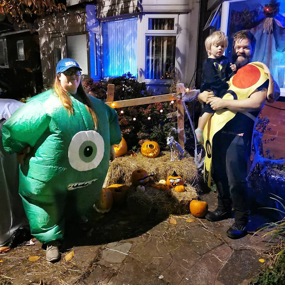 a family wearing pixar related halloween costumes