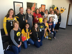 Uyen and her colleagues repping their favorite college football teams at work during Football Friday. networking. career. success.