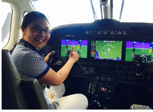 Uyen in the company jet, during her intern days at Collins Aerospace. networking. career. success.