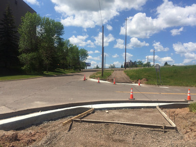 ADA ramps and curb crossing Recycle Way at Ramsey St next to Recycle Plant