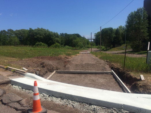 ADA ramps and curb crossing natural gas pipe access road