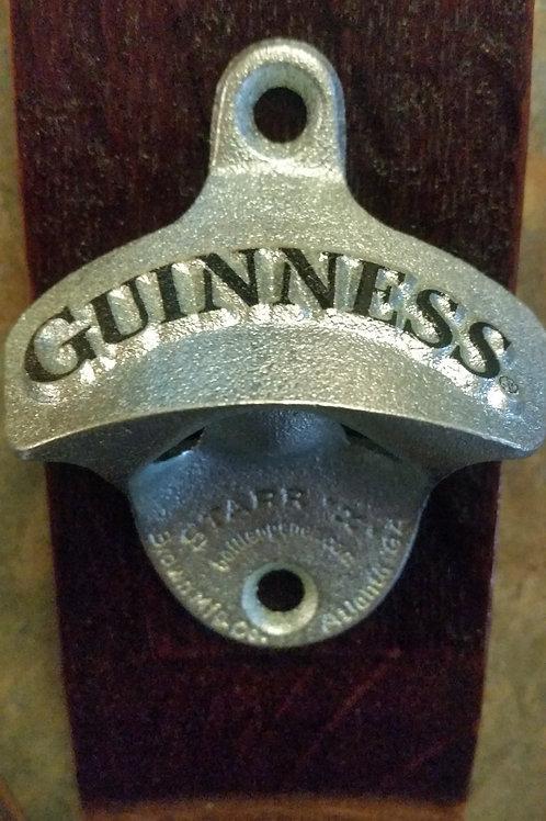 Guinness bottle opener on wine barrel stave