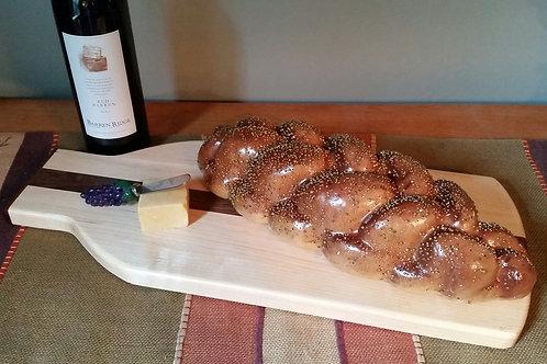 Maple and walnut wine bottle cutting/serving board