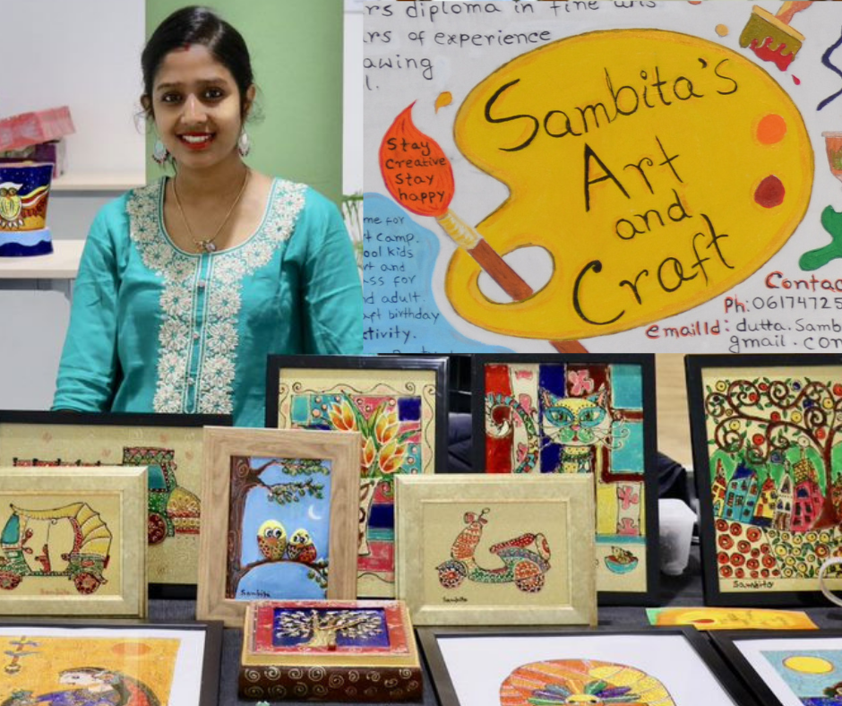 Sambita with a collection of her amazing work