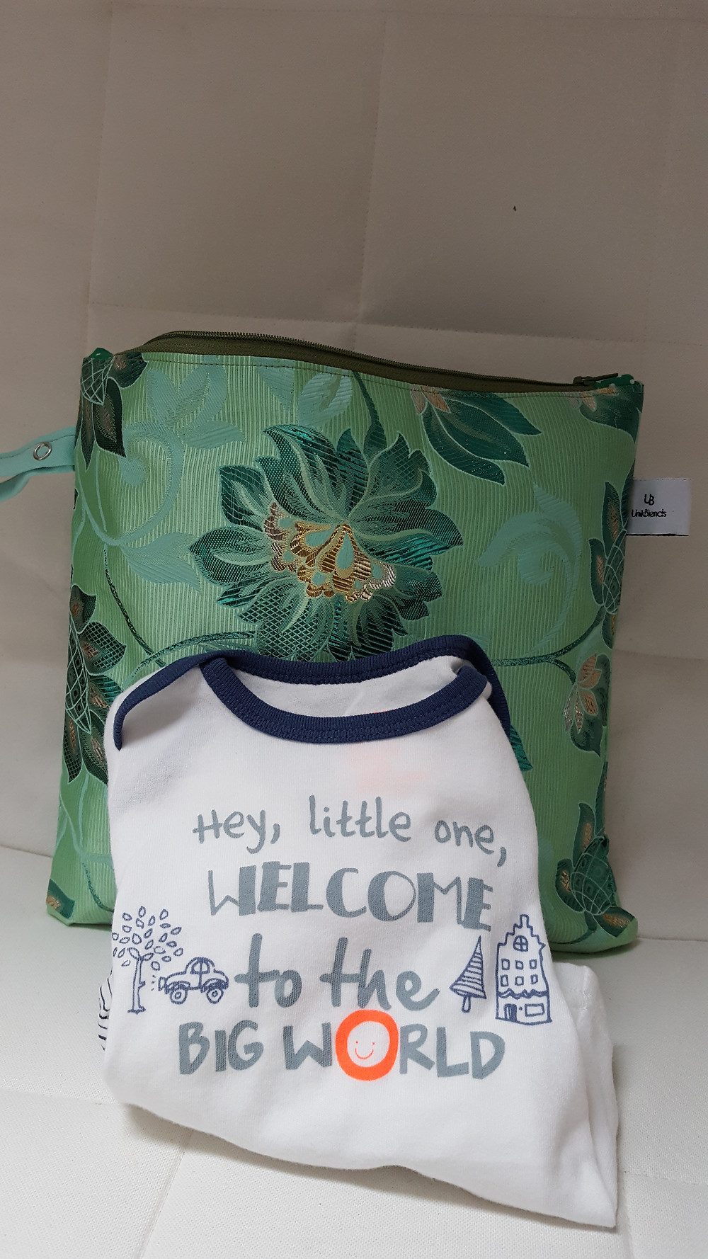 You can make a difference by donating baby products like this bag made from recycled fabrics to support Nina's work