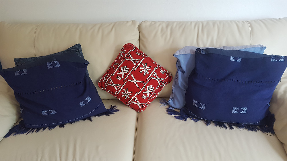 My humble living room adorned with cushion pillows made from my wedding gele and Asoebi