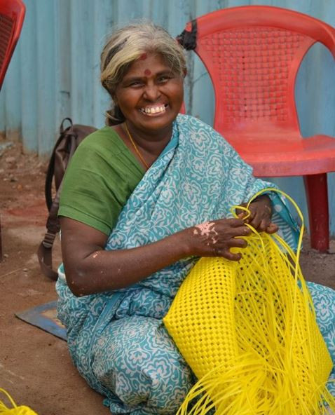One of the mums proudly hand weaving a basket