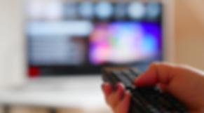 Girl-using-TV-remote-control.-Free-HD-vi