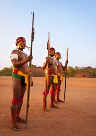 Sagagi, Airã and Lamati; Matipu warriors stand guard against evil spirits during the Kuarup