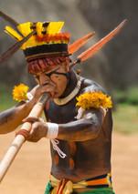 Keinahu Kuikuro plays the Taquara flute for the hummingbird festival